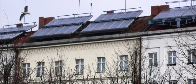 Solar Cells on the roofs of residential homes in Berlin - symbol for the growing democratization of power in Germany