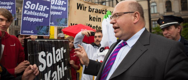 Federal Minister Altmaier facing protest against cuts in support for renewables in 2012. (Photo by campact, CC BY-NC 2.0)
