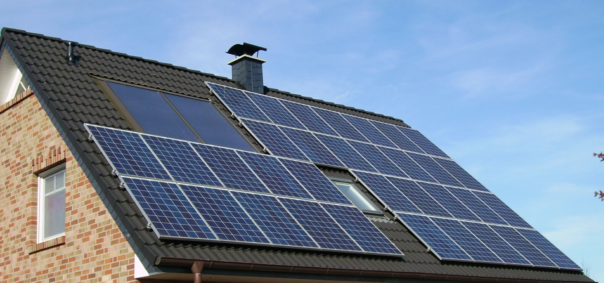 solar panels on the roof of a brick house
