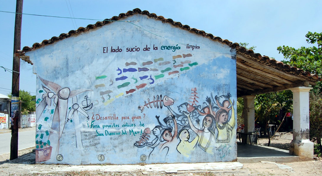 """The dirty side of wind energy"", depicts a wall in San Dionisio del Mar, Oaxaca, in the South of Mexico"