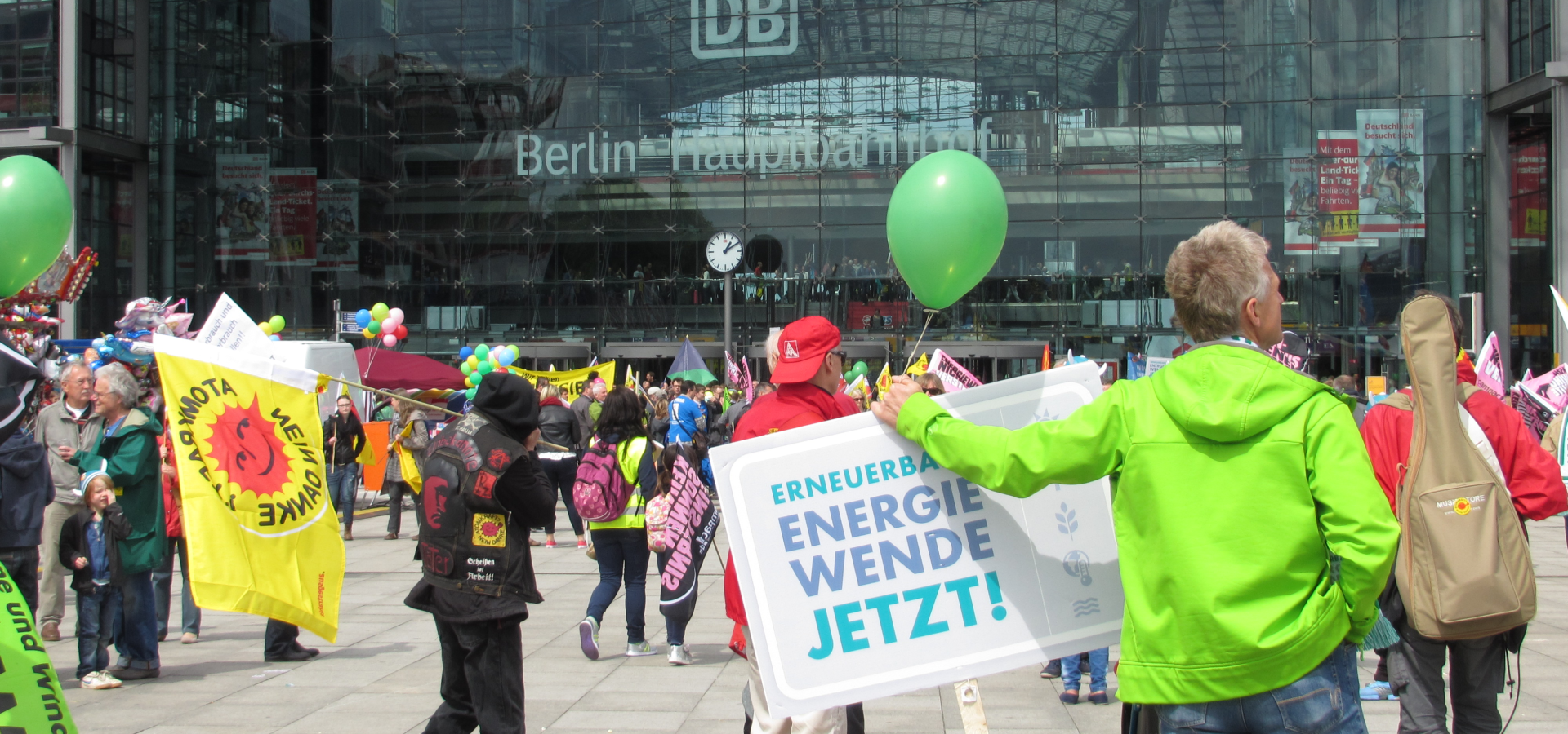 People are preparing for a demonstration for the energytransition in front of the main station in Berlin.
