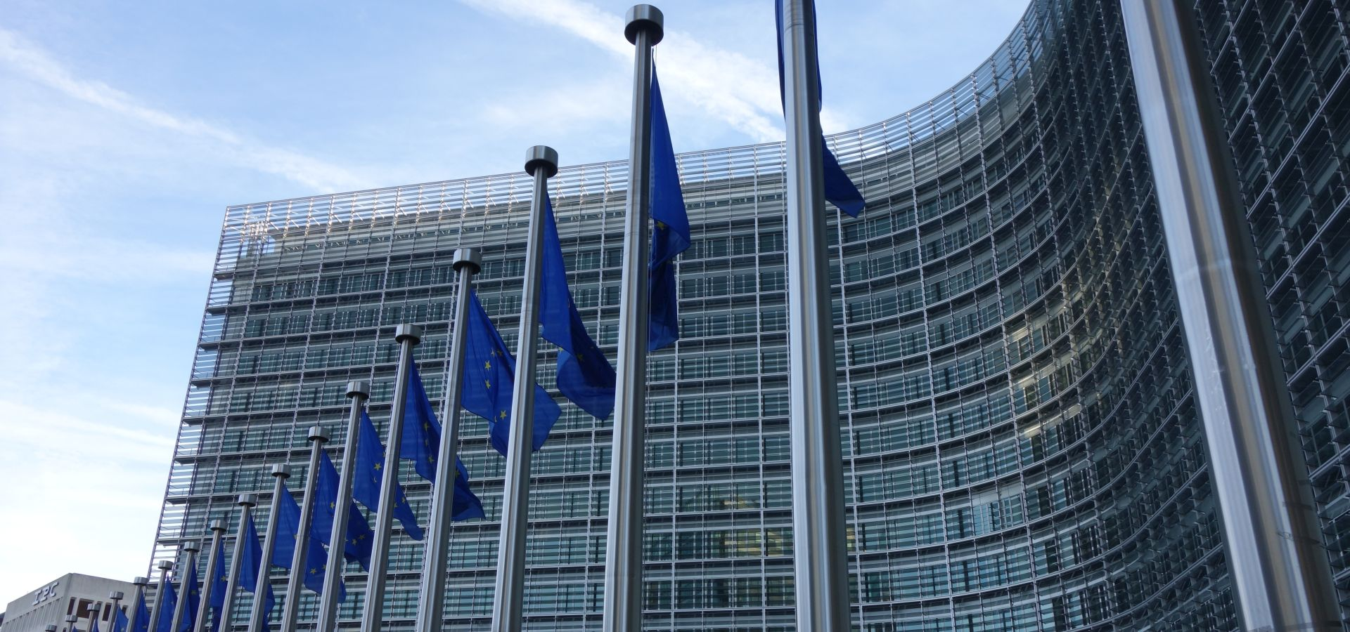 The Berlaymont building in Brussels with flags of the European Union in front of it.