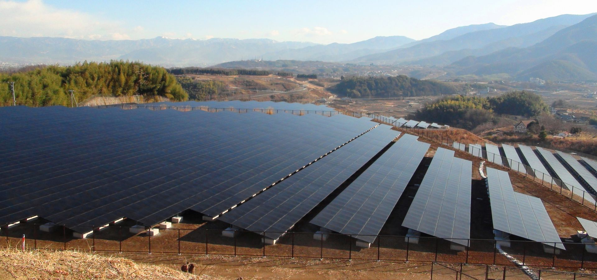 A huge solar farm in front of a dry landscape in Japan.
