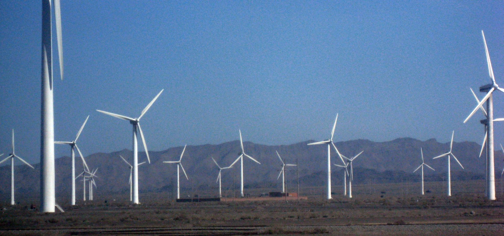 Wind farm in Xinjiang, China, on a sunny day.