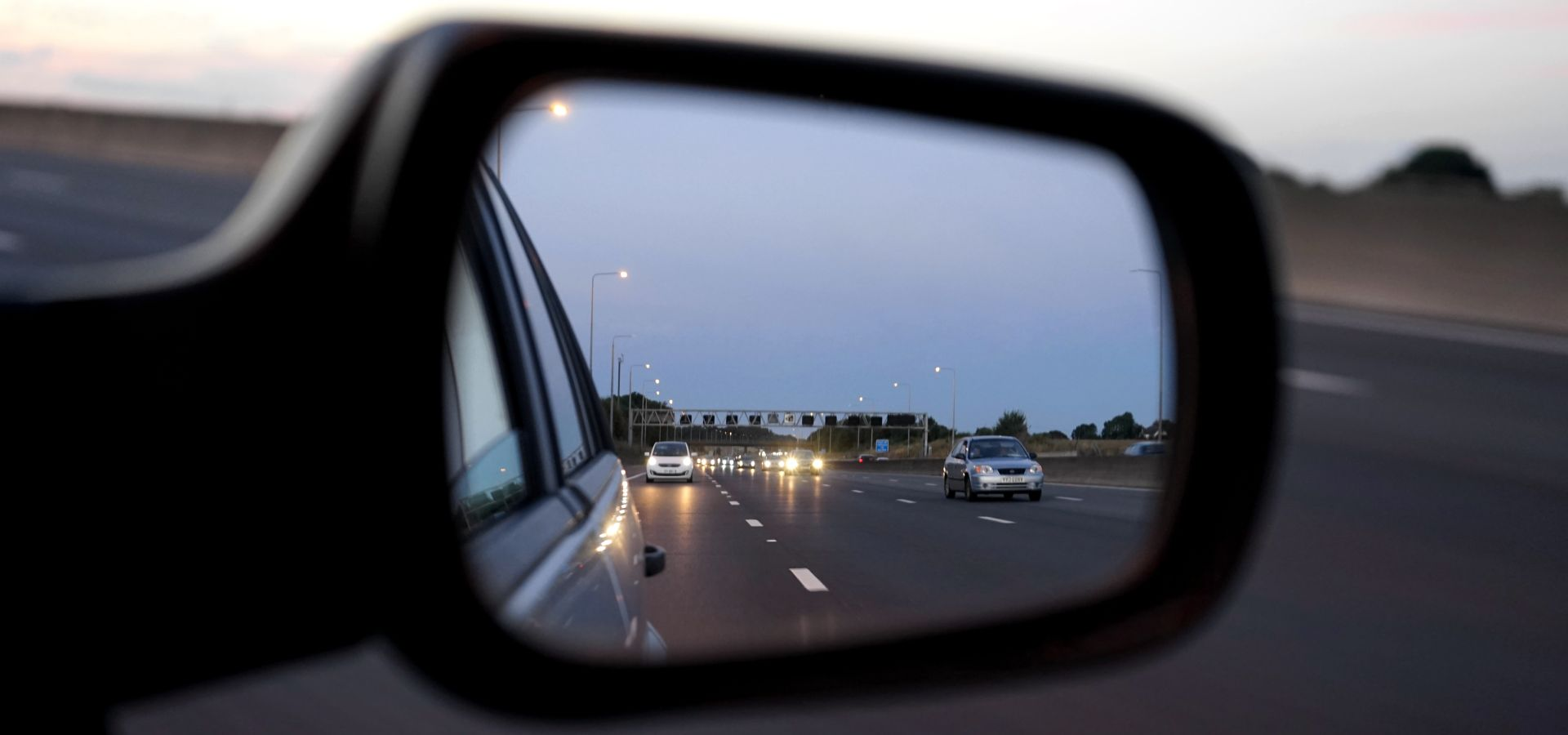 view of the autobahn from a rear view mirror