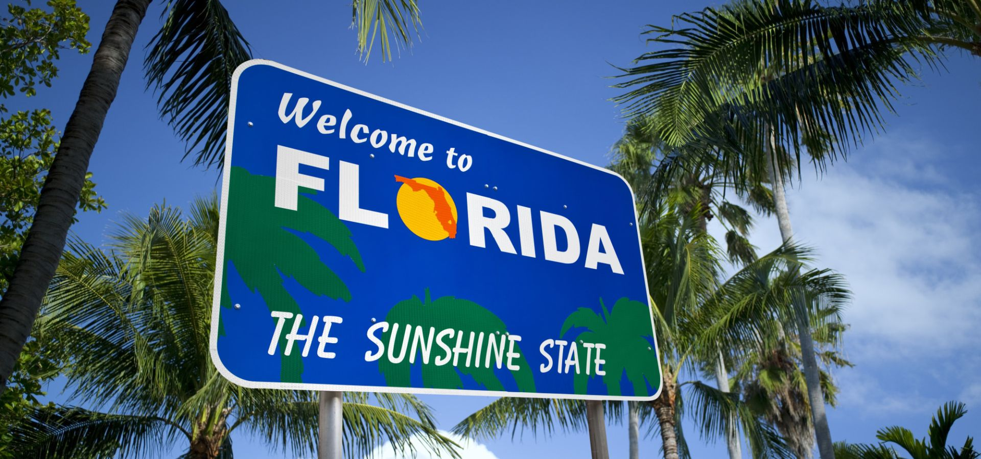 "the Sunshine State is seeing an anti-solar movement, financed by big business. ""welcome to florida, the sunshine state"" sign"