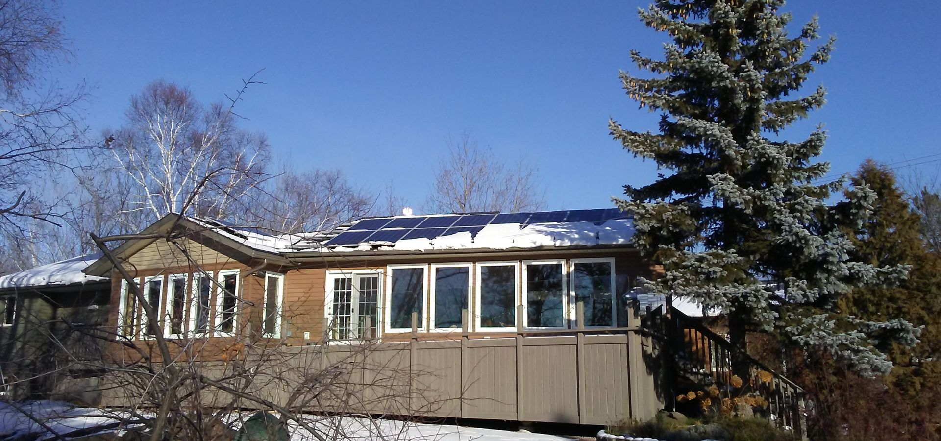 solar panels on a roof in ontario in the snow
