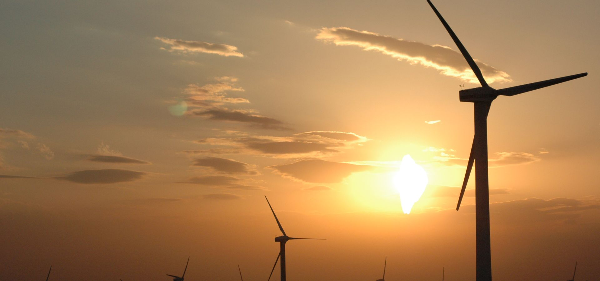 windmills in the sunset in China