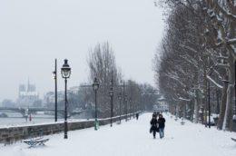 Quai de la Rapee in the snow, view of Notre Dame Cathedral
