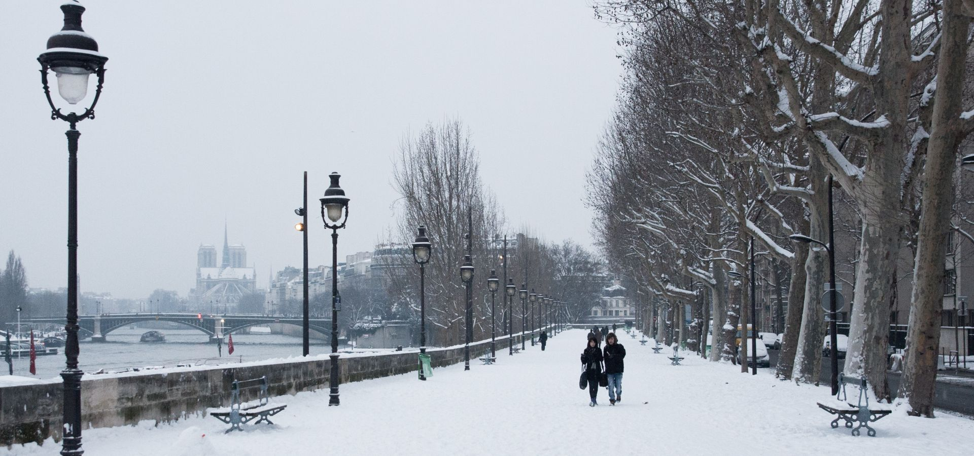 Quai de la Rapee in the snow, view of Notre Dame Cathedral