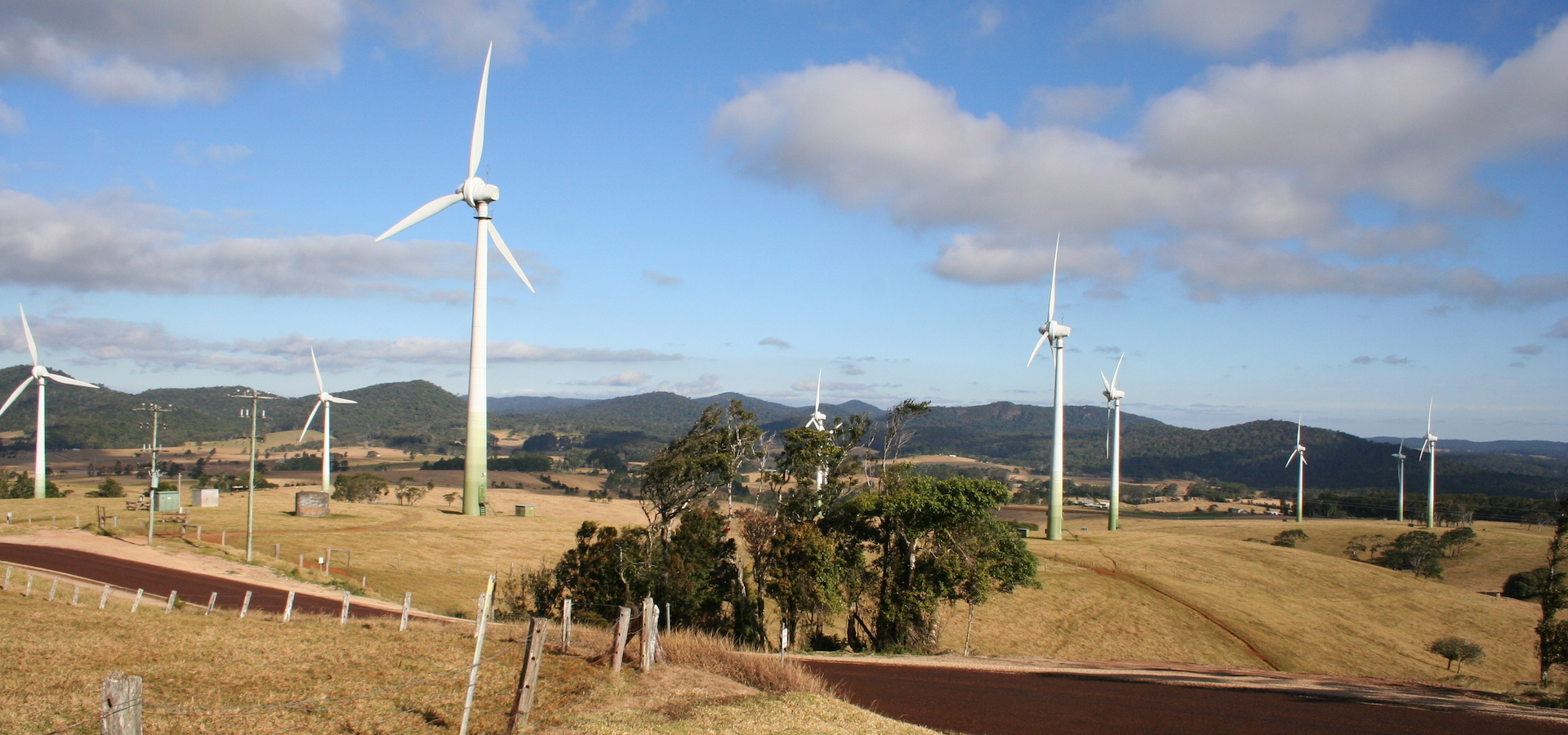 wind farm in Australia with mountains in the background