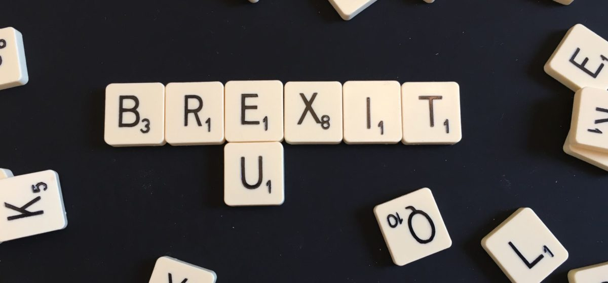 scrabble text with the words brexit and EU spelled out on a black background