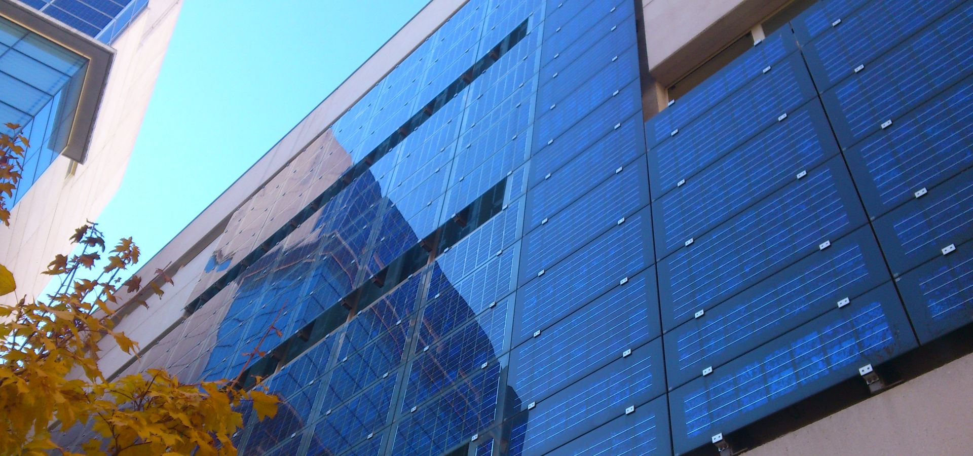 solar panels on the front of a modern building in Spain