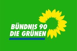 logo of the German Green party, reading Bündnis 90 die Grünen with a green background and yellow sunflower