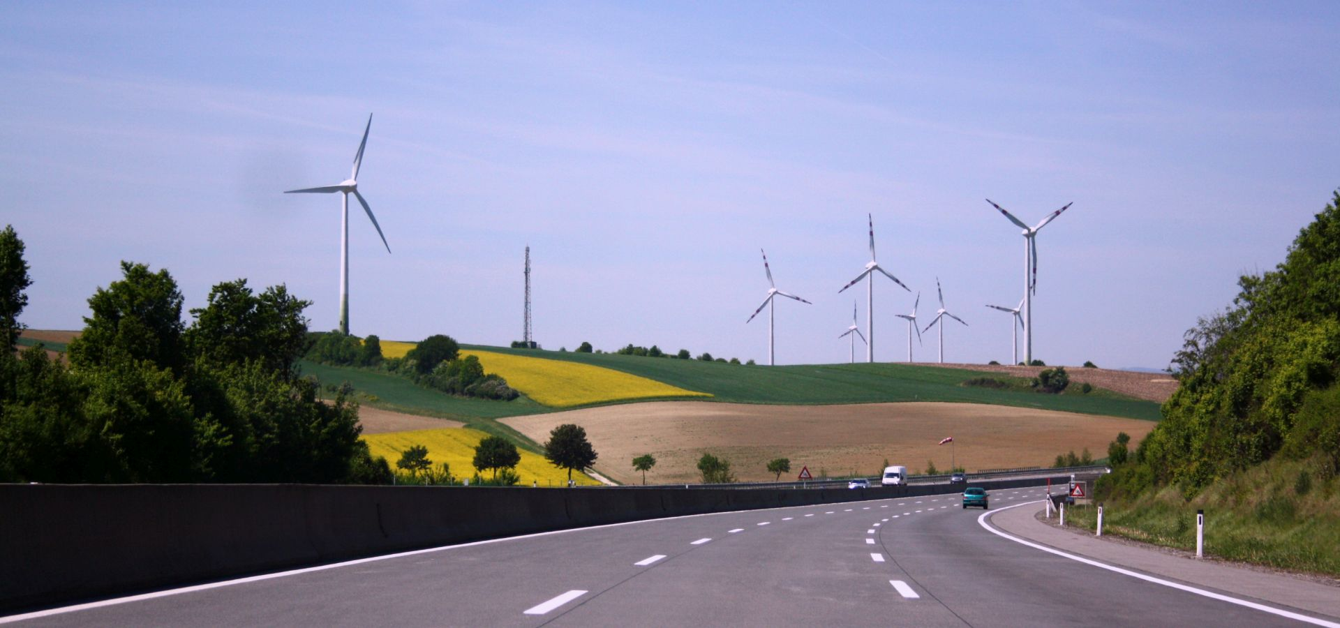 Windmills against a blue sky seen from the German autobahn