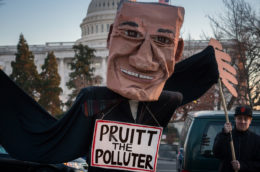 """protest puppet in front of white house labelled """"Pruitt the polluter"""""""