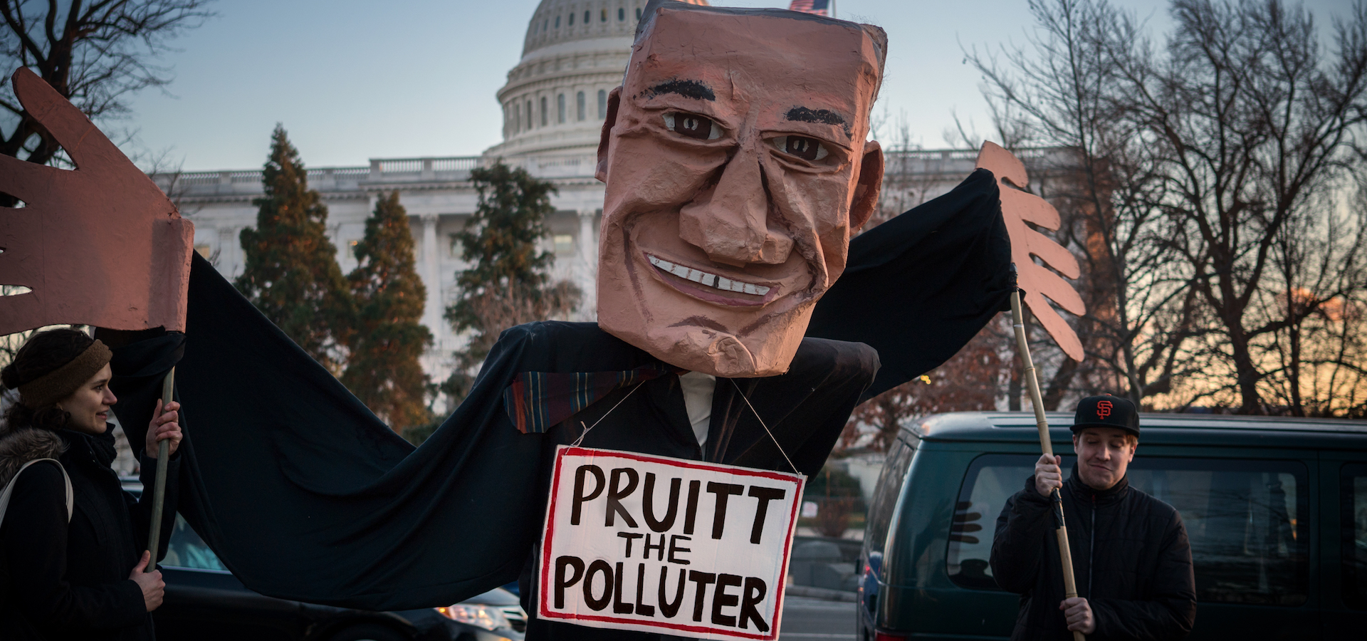 "protest puppet in front of white house labelled ""Pruitt the polluter"""