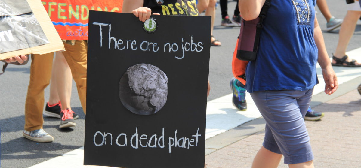 "People's Climate March 2017 in Washington DC. Marchers with sign, ""There are no jobs on a dead planet."""