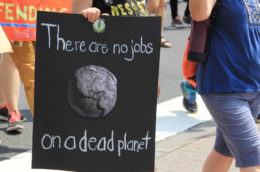 """People's Climate March 2017 in Washington DC. Marchers with sign, """"There are no jobs on a dead planet."""""""