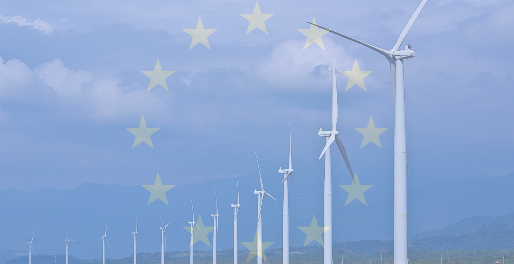 overlay of the EU flag on windmills along a coastline