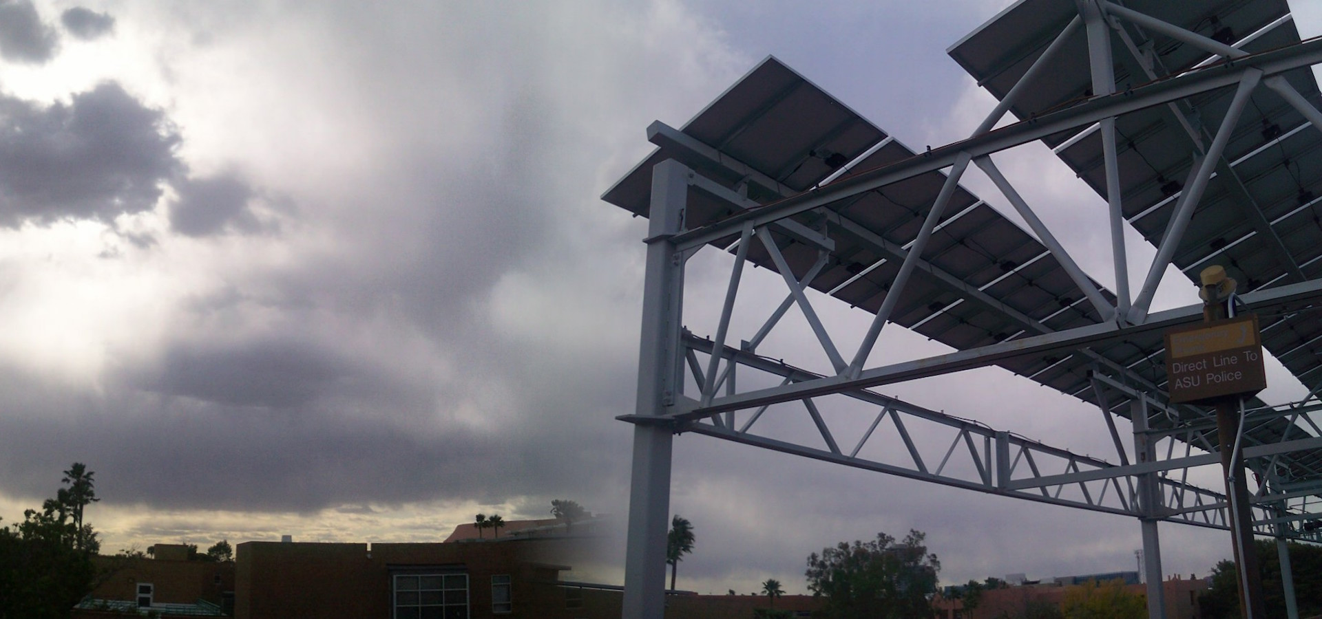 solar installation with stormclouds behind
