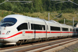a German high speed train (ICE) coming out of a tunnel and into the woods