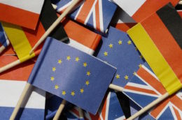 A pile of small paper flags from the EU, Germany, France and the UK