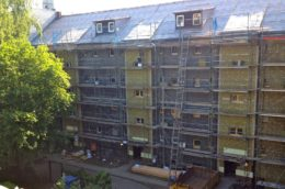 image of an apartment block being fitted with insulation