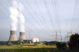 view of the cooling towers with steam, clouds