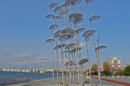 view of the seaside at Thessaloniki, Greece with statue of flying umbrellas