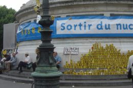 Bastille column in Paris with banner reading sortir du nucleaire
