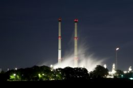 natural gas cleaning plant towers glowing at night