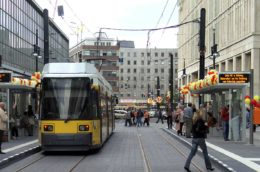 view of a tram with people crossing the street in Berlin, Alexanderplatz