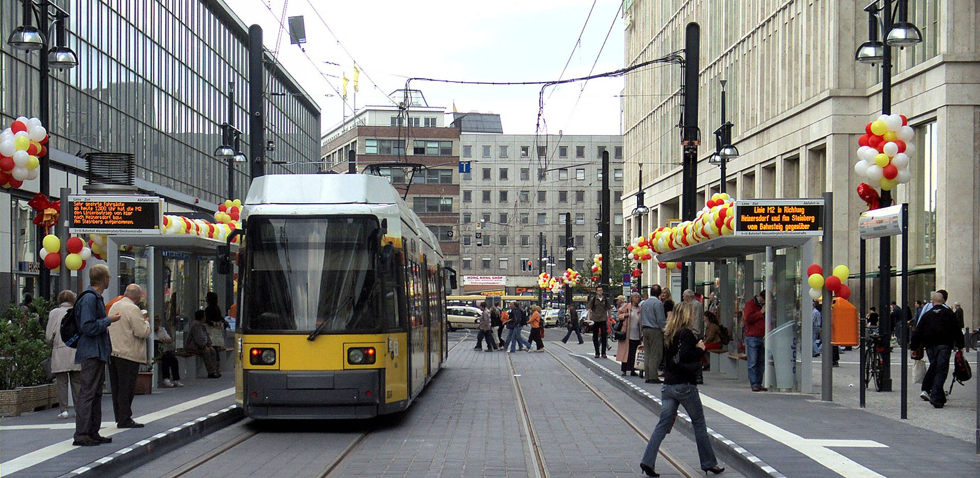 view of a tram with people crossing the street in Berlin, Alexanderplatz