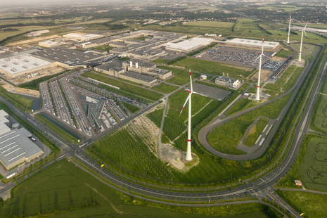 Four modern wind turbines installed at BMW's electric car manufacturing plant in Leipzig (2013) as seen from above