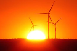 sunrise with three wind turbines in the foreground