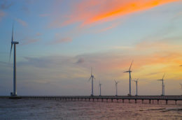 Offshore wind with sunset reflected in water