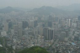 view of Seoul's skyline covered in smog and dust