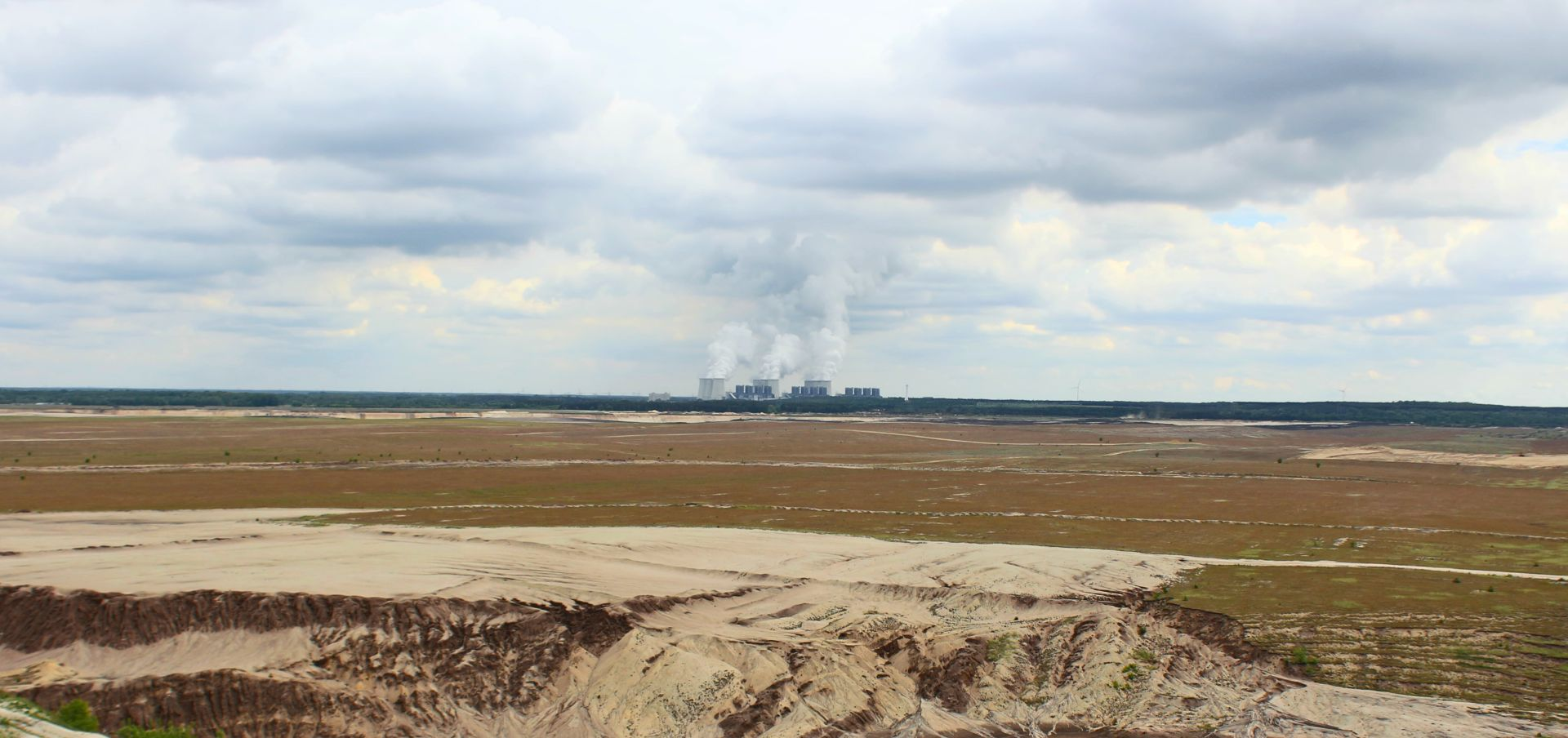 panorama of old coal mine with cooling towers in the background