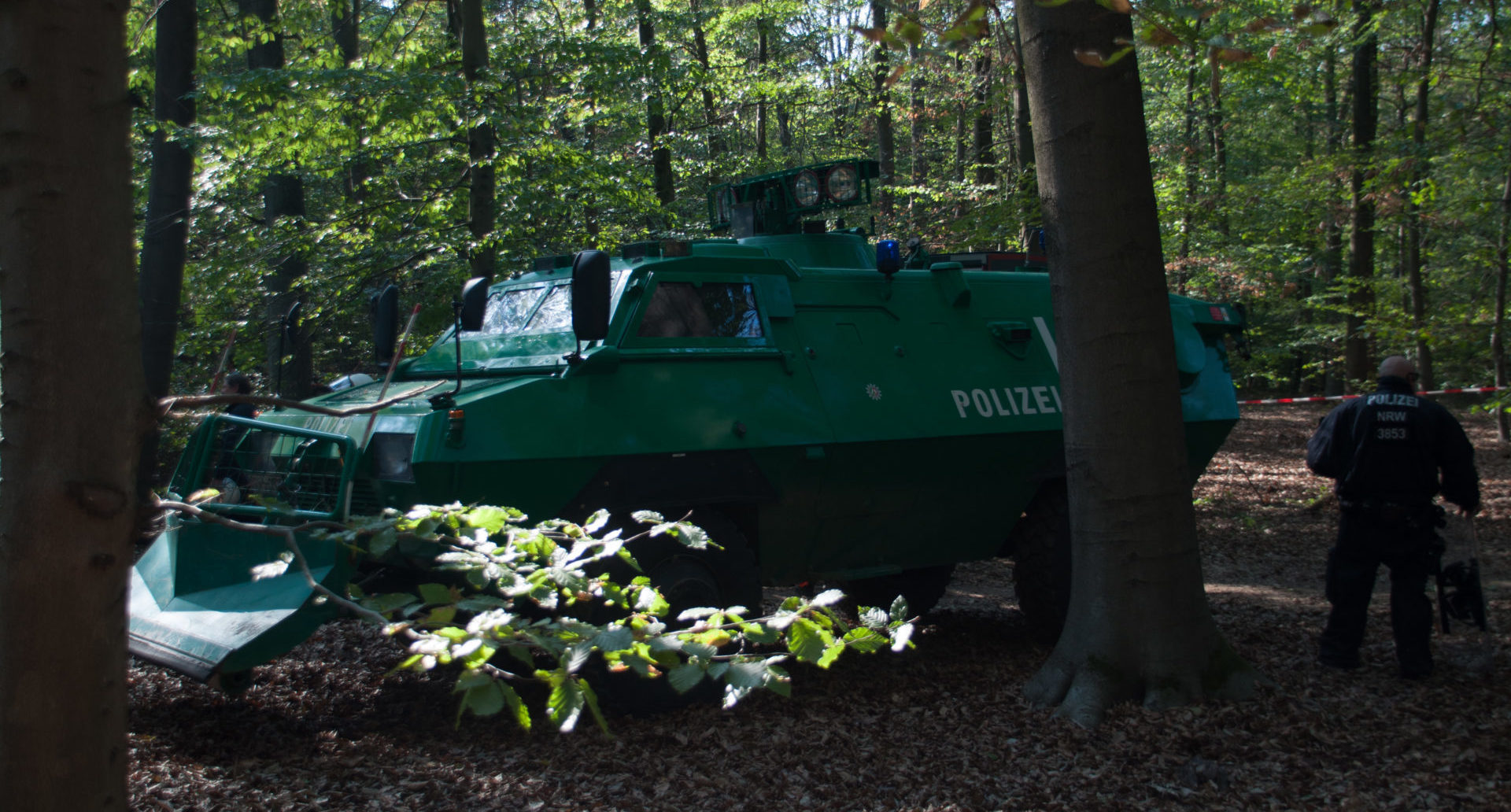 The police is trying to clear the Hambach Forest. A tank is used to force the peaceful protesting activists to leave there tree houses